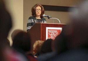 "Julie Kohner, founder and CEO of Voices of the Generations, speaks to a crowd during a presentation called ""Voices of the Generations: Stories from the Holocaust"" at the National Czech and Slovak Museum and Library in Cedar Rapids on Thursday, Mar. 12, 2015. (Stephen Mally/The Gazett"