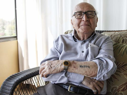David Wolnerman, 88 of Des Moines, is one of the few remaining Holocaust survivors currently living in central Iowa. At the age of 13 he was taken from his home in Poland to Auschwitz where the number 160344 was tattooed on his arm, he was liberated from the Dachau concentration camp in 1945. (Photo: Kelsey Kremer/The Register)